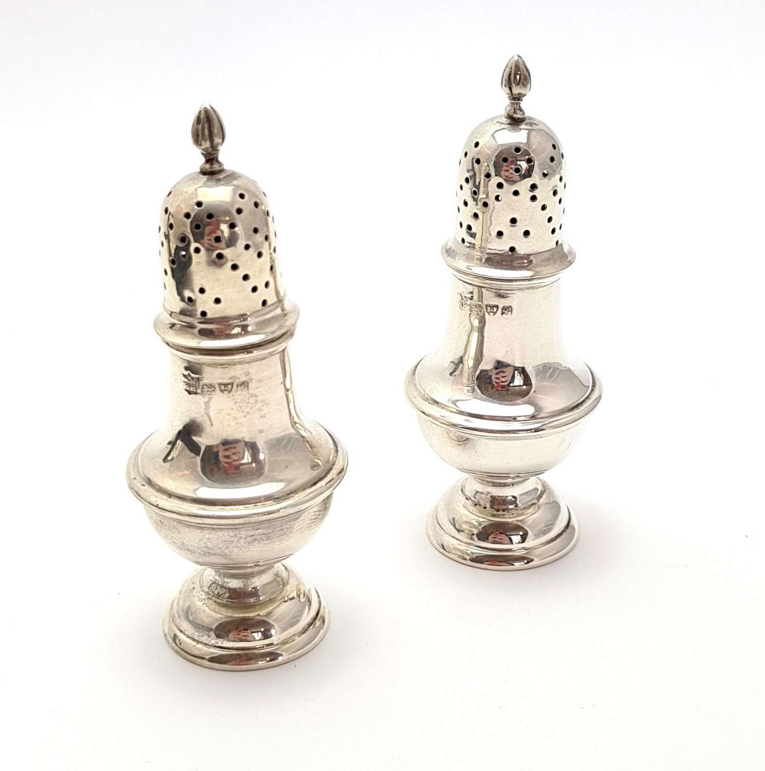 Pair of Cased Silver Pepper Shakers