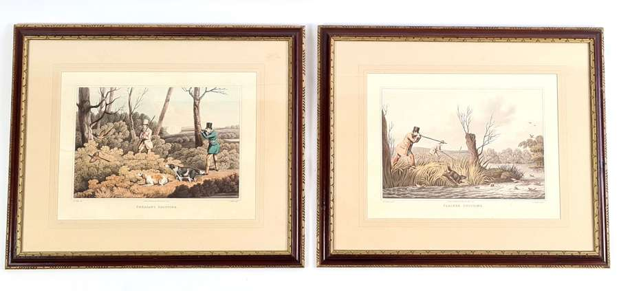 A Pair of Hand Coloured Aquatints