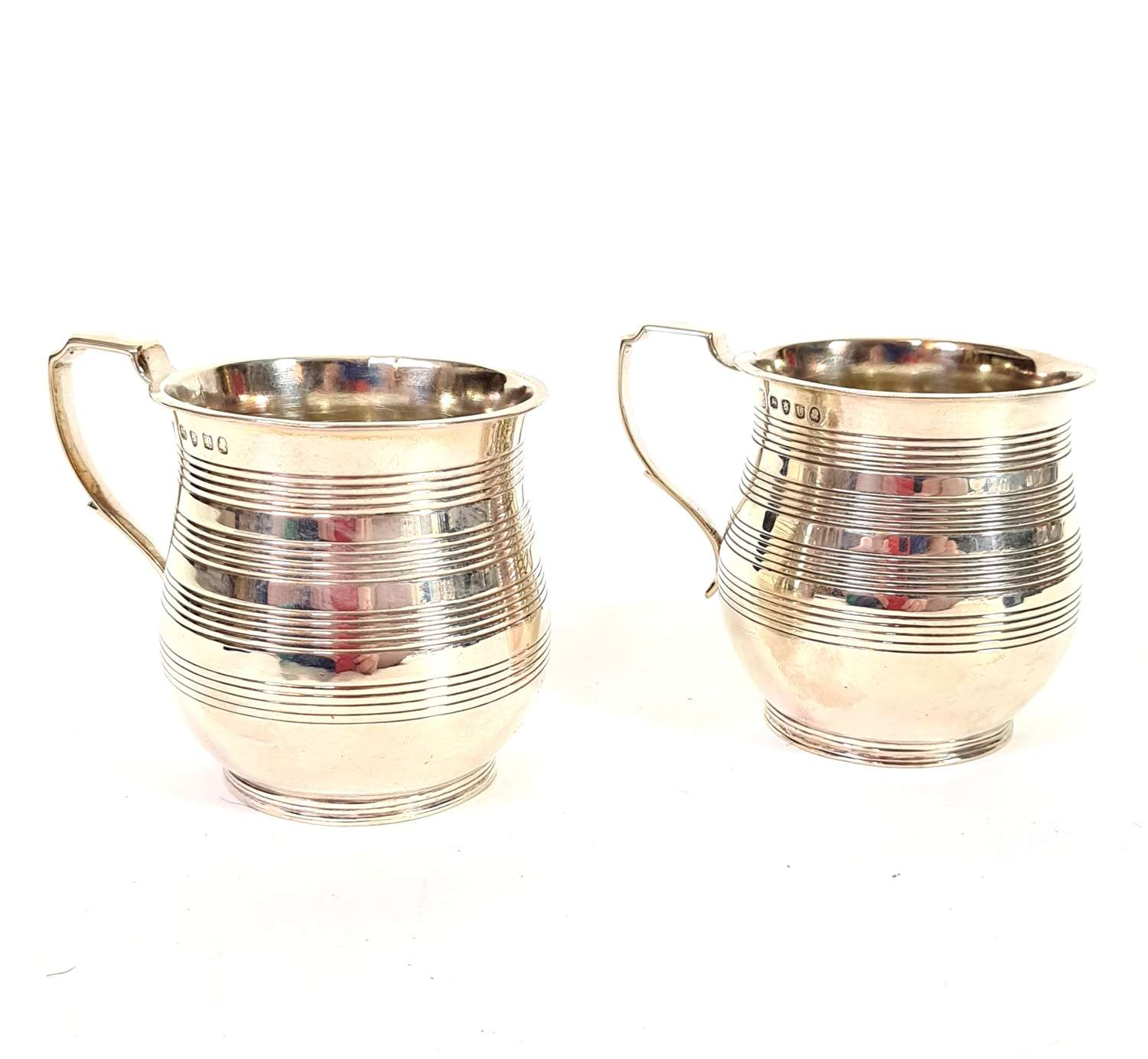 Pair of George III Silver Mugs