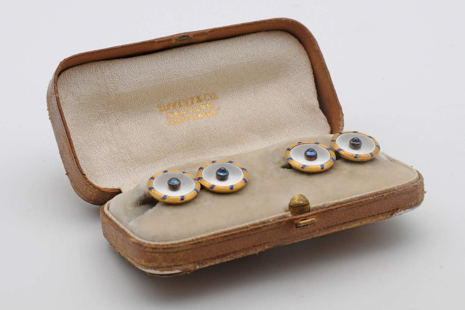 A pair of early 20th century French sapphire, mother of pearl and gold