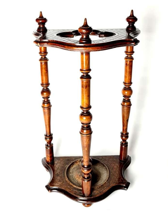 A Walnut Stick Stand